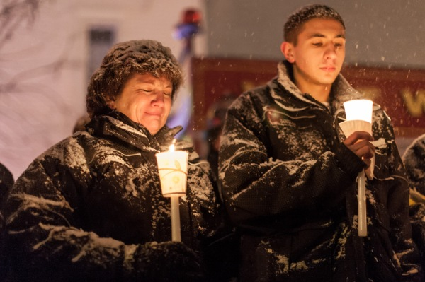 [POTW wek 4-5, Third Place] In Webster, NY, West Webster firefighter Vicki Polkowski cries with fellow firefighter, Pat Quigley, at a vigil held for two West Webster volunteer firefighters, Tomasz Kaczowka, a 911 dispatcher in his early 20s, and Michael Chiapperini, a 43-year-old lieutenant with the Webster Police Department, December 26, 2012. After arriving at a car fire which set ablaze seven homes on Lake Rd, both men were killed after being shot at on the morning of Christmas Eve by 62 year old William Spengler. The vigil was organized by the owners of Barry's Old School Irish restaurant on Main Street in Webster.
