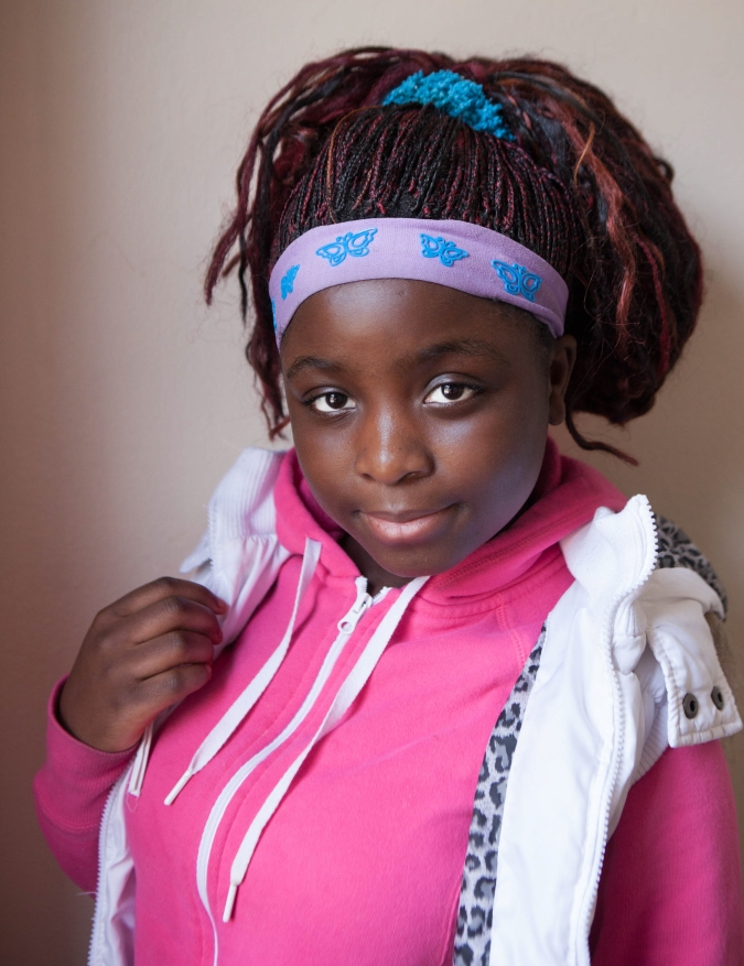 Salome Kasinge, 14, a refugee from Zambia, poses for a portrait at Mary's Place, a refugee outreach center in Rochester, NY. Salome came to the United States when she was 11 and Mary's Place helped her learn English quickly.