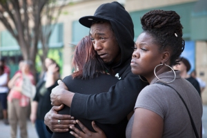 Katrina White (right), Sean Nuvoni, and Desirae Phelps hold on to each other during a rally held in Rochester on Friday, April 20, 2012. The rally was held to remember their close friend, Lawrence Richardson, who was fatally shot on Monday, April 9, 2012.