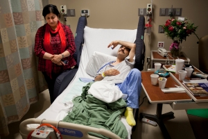"Recovering from a brain hemorrhage and tumor surgery, Ali Hekmati rests in a hospital bed at Providence Park Hospital next to his wife, Behnaz Hekmati, in Novi, Mich. on Sept. 23, 2012. The couple's son, Amir Hekmati, a Flint Central High School graduate, was taken prisoner by Iranian authorities over a year ago during a trip to visit family in the country. Speaking about her first visit to Iran to see her son after his detainment, Behnaz said, ""As a mother, I know him. When I looked at his face, I knew he was going through so much pain and loneliness."""