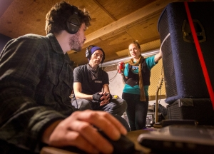 (Left to right) Adam Schmitt, Austin Codding, and Rebecca Mryglod work on recording their first ep for their band, Smoked Syndicate. The band, which was started 8 months ago, plays a mixed genre, consisting of folk, blues and rock.