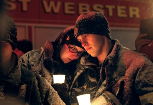 Webster firefightersat a candlelight vigil in Webster, NY on Wednesday, December 26, 2012. The vigil was held to remember firemen Michael Chiapperini and Tomasz Kaczowka who were shot and killed while responding to a fire on Christmas Eve morning.