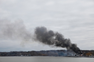 A fire which broke out on the morning of Monday, December 24, 2012 continues to burn hours later in Webster, NY. Four firefighters were shot while responding to the fire and two are dead.