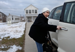 JoAnn Pacelli packs up her car on Lake Road to go to her sisters after a fire broke out at a neighbors in the early morning on Monday, December 24, 2012. Four firefighters were shot on the scene and two are dead.