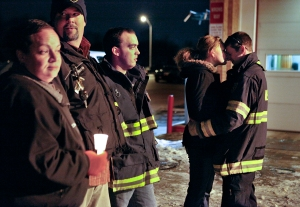 Victoria Michaels kisses her boyfriend, a Webster Volunteer Fire Fighter on Monday, December 24, 2012 at the Webster Fire Hall. Her boyfriend was one of the firefighters present when William Spengler opened fire on first responders fighting a fire at his house.