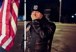 Bill Ferr, a Patriot Guard, cries as he looks at a memorial at the Webster Fire Hall on Monday, December 24, 2012. Hundreds came out to remember first responders who lost their lives after William Spengler opened fire when they came to fight a house fire, killing two firemen and injuring several others.