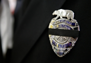 Firefighters from around the country wear mourning badges during Tomasz Kaczowka's funeral in Rochester, NY on Monday, December 31, 2012. Kaczowka, 19, was one of two firefighters who was shot and killed while responding to a fire on Christmas Eve by William Spengler in Webster, NY.