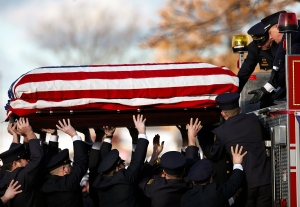 Webster policemen and firefighters load the casket of Michael Chiapperini onto a Webster Fire Truck after a funeral service at Webster Schroeder High School on Sunday, December 30, 2012. Firefighter and Lieutenant Chiapperini was shot and killed after William Spengler, a Webster resident, lit his house on fire and shot at first responders on Monday, December 24, 2012.
