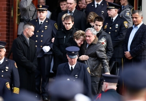 Tomasz Kaczowka's family mourns as they come out of the church doors after his funeral in Rochester, NY on Monday, December 31, 2012. Kaczowka, 19, was one of two firefighters who was shot and killed while responding to a fire on Christmas Eve by William Spengler in Webster, NY.