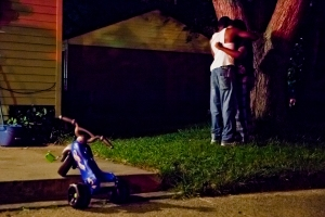 Gun Violence In Flint - Family members console each other after the alleged robbery and critical shooting of 19-year-old Sammie Milton Jr. in Flint, Mich. on September 18, 2012.