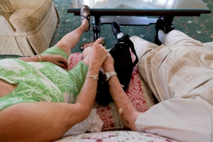 Joyce Kleber, 71, and her fiancé, Frank Maslyn, 95, hold hands while waiting for a musical performance at Legacy Senior Living Communities on Monday, May 21, 2012. (Photo by Autumn Parry)