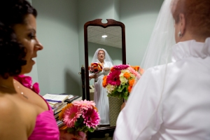 "Bridesmaid, Pam Devos, helps Joyce Masly, 72, adjust her gown before the ceremony at Sacred Heart Cathedral in Rochester, NY on June 16, 2012. ""If you were to tell me, six or seven months ago, that I'd be getting married – I'd say you're crazy,"" says Joyce, who was use to living alone. (Photo by Autumn Parry)"