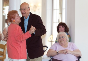 Joyce and Frank dance at Legacy Senior Living Communities on Saturday, May 12, 2012. Their love for dancing keeps them coming to the Legacy every week for musical performances. (Photo by Autumn Parry)