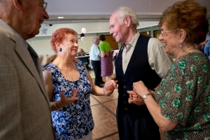 Klaus Wesenberg and his wife, Trudy, congratulate Joyce and Frank on their engagement during the Senior Sock Hop at the Greece Community and Senior Center on Saturday, May 14, 2012. (Photo by Autumn Parry)