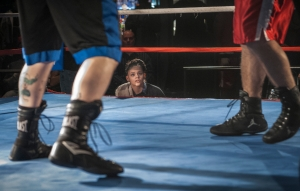Celina Carissimi watches as her teammate fight at the Golden Golves Boxing Tournament February 16, 2013. Between rounds Celina helps her coach work the corner by providing water and towelling sweat from eyes.