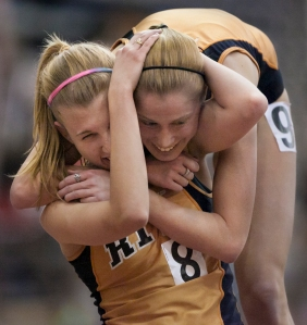Rachel Zoyhofski, left, and Amanda Dole of the Rochester Institute of Technology hug after finishing the 5000 meter run at the Liberty League Indoor Track and Field Championships at RIT's Gordon Field House in Henrietta, N.Y., on Saturday, Feb. 9, 2013. Both women hit the qualifying standard for the ECAC Championship meet after running the race mostly together and finishing a little more than a second apart.