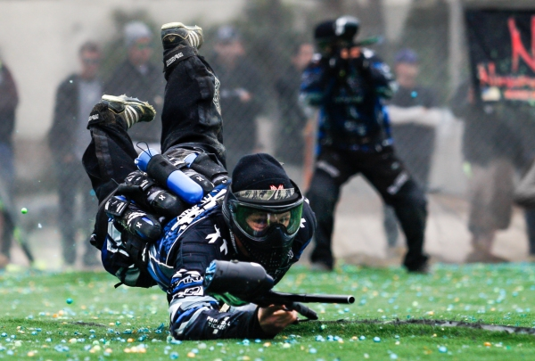 San Diego Dynasty player Dalton Vanderbyl dives for cover seconds after the start of a point against Portland Uprising during a National Professional Paintball Leauge event in Huntington Beach, California on April 14, 2013.