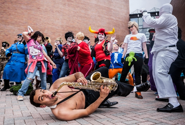 "Rochester Institute of Technology third year Imaging Science major Sam Valerio (center) plays his saxophone during a ""Harlem Shake"" video during ""Tora-Con"" day, on March 23, 2013."