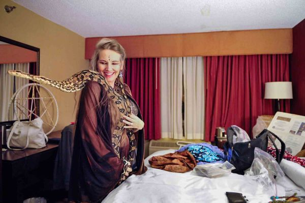 Snake priestess Serpentessa with two of her boa constrictors in her room at the Radisson Hotel after performing a belly dance during the Rochester Erotic Arts Festival April 5, 2013.
