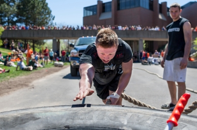 "Second year Biomedical Science major Alex Schepler reaches for the giant tire to finish pulling a pickup truck during a ""Strongman"" weight lifting competition in Henrietta, NY, on Saturday, May 4, 2013. (Tom Brenner)."