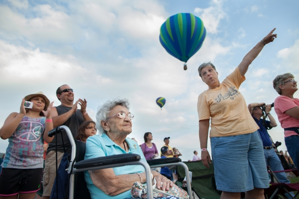 Surrounded by family, Gertrude Zelma, 93, of Akron, NY, watches hot air balloons launch at the 32nd Annual New York State Festival of Balloons in Dansville, NY on Aug. 31, 2013. Gertrude's niece, right, teased that the family will send her up in a hot air balloon on her 100th birthday.