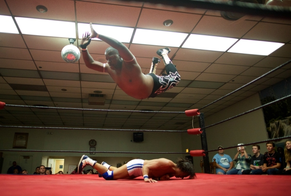 9/21/13 - At the Eagles Club in Rochester, NY Professional Wrestler Gabrael Saint leaps from the ropes onto his Japanese opponent Shoichi Funaki. Photo by Joe Philipson