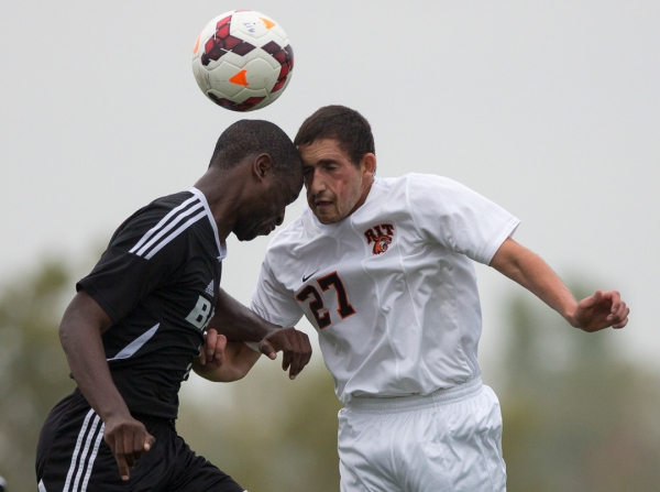 Kurt Spiegel a Junior at RIT bangs heads with Gabriel Kilongo a Junoir at Bard College during a Mens soccer game between RIT and Bard College in  Henrietta New York on10/4/2013 which ended with a final score of 4-0 RIT. Photo by Flannery Allison
