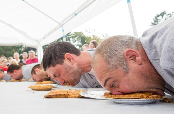 Doug (right) competes in the annual pie eating contest hosted by Apple Fest in Hilton, New York on Sunday October 6, 2013. Photo by Tom Brenner.