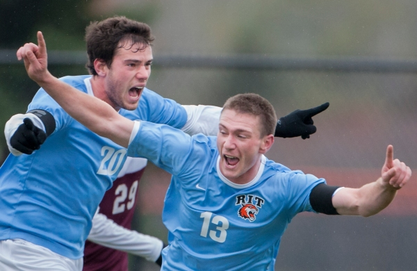 Andy Fleckenstein of RIT #20-senior captain, left, and Jimmy Forbes of RIT #13-senior captain, right, celebrate Forbes' goal during the the first half of the men's soccer game against Union at Rochester Institute of Technology's Tiger Stadium in Henrietta, N.Y., on Saturday, Oct. 26, 2013. RIT won 1-0. (Photo by Josh Barber/RIT SportsZone)