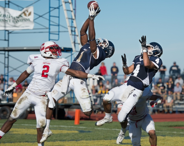 Joel Lynch of Ithaca College #1-junior WR, center attempts to catch the ball in the end zone above Ke'shaun Stallworth of SUNY Cortland #2-sophomore DB, as time expires in the second quarter during the 2013 Cortaca Jug football game at Ithaca's Butterfield Stadium in Ithaca, N.Y., on Saturday, Nov. 16, 2013. Officials ruled that Lynch did not have control of the ball when he touched the ground. Cortland won the game 28-24 to lengthen their winning streak to four years. Photo by Josh Barber