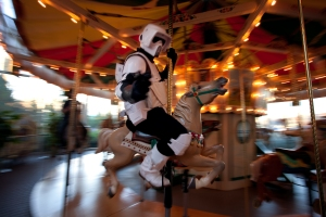 "Andrew Mucciante takes a ride on the carousel at the Strong National Museum of Play in Rochester, NY while  dressed as a 'Bike Scout' Stormtrooper for the museum's ""In Another Galaxy"" weekend on November 16th, 2013. Photo by Kristy Knowles"