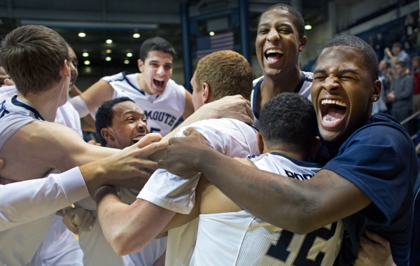 Monmouth University men's basketball celebrates after upsetting Canisus College 83-82 during a regular season game on January 19, 2014 at the Monmouth Activities Center in Long Branch, New Jersey. Photo by Tom Brenner