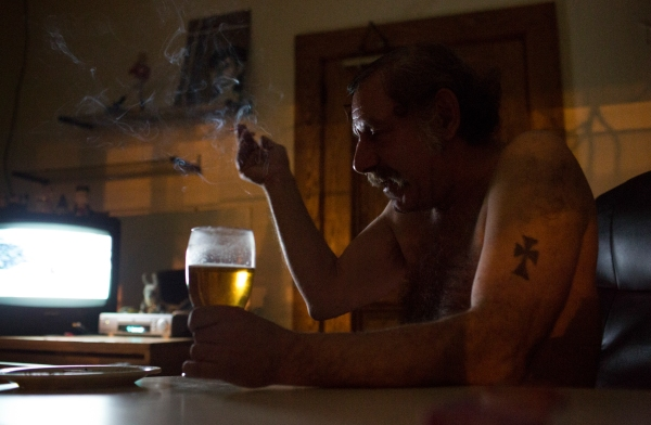 "Bradley Loce, 56, takes a quiet moment in his Dorothy Day House apartment in Rochester, NY on Feb. 23, 2014. ""My son hasn't talked to me in fifteen years. He's ashamed of me because I'm a drunk. Can't blame him. I'm not a criminal though.""  Bradley has suffered from alcoholism his entire life, has struggled with chronic homelessness and mental illness diagnosis that he rejects, refusing medication. The Dorothy Day House has been in place since late 2012, providing a housing first solution for people that are on the streets. Photo by Zack DeClerk"