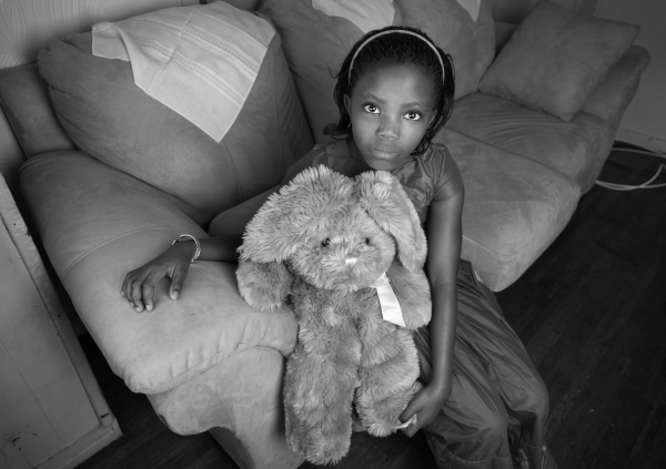 Nyota Kamali, 8, is a refugee from the Democratic Republic of Congo who recently arrived in the United States and moved into an apartment with her family in Rochester, NY. Saint's Place prepared the apartment before her family moved in, providing furniture, decorations and toys. Photo by Sarah Ann Jump