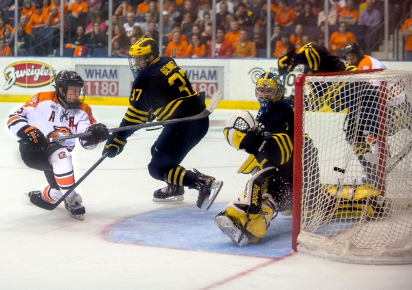 Rochester Institute of Technology co-captain Ben Lynch-#15 scores a goal against University of Michigan during the Brick City Homecoming game on October 12, 2014 at the Blue Cross Arena in Rochester, New York. Photo by Tom Brenner