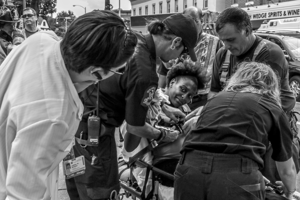 Pregnant woman involved in a four-car accident on South Avenue, Rochester, NY on July 31, 2013. Paramedics secure her to a stretcher. Photo by Zack DeClerk