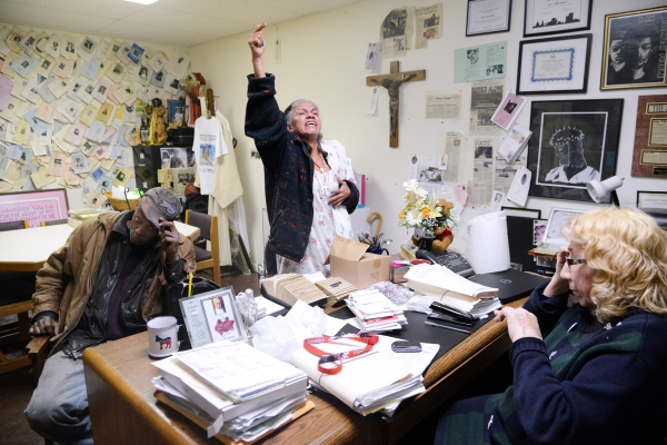 "Sister Grace Miller, right, calls residents ""Handyman"", left, and Elena, center, into her office to resolve a dispute on Tuesday, December 17, 2013. Handyman was intoxicated and referred to Elena, who has breast cancer, as a ""cancerous bitch."" Photo by Emily Kask"