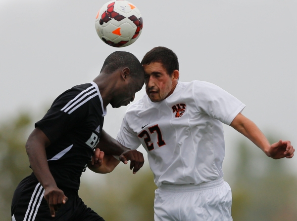 Kurt Spiegel a junior at Rochester Institute of Technology bangs heads with Gabriel Kilongo a junior at Bard College during a MenÍs soccer game between RIT and Bard College in Henrietta, New York on October 4, 2013, which ended with a final score of 4-0 RIT. Photo by Flannery Allison