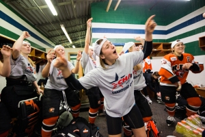 "Members of RIT Tigers women's hockey team dance to Pitbull's ""Timber"" after winning the CHA Championship at Mercyhurst Ice Center on Saturday, March 8, 2014 in Erie, Pa. Photo by Emily Kask"