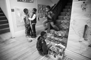 Mary's Place, a non-profit refugee outreach center in Rochester, NY, offers many essentials to families as they arrive in America for the first time, but most importantly provides a welcoming community for people from over the world.) Desire Kasinge, 10, (bottom) a Congolese refugee from Zambia, plays with a recently donated dollhouse.
