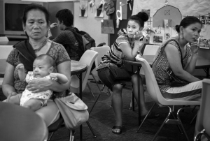A family of Karen refugees from Burma waits to see a casework counselor at Mary's Place, a refugee outreach center in Rochester, NY. The volunteer casework counselors help refugees through the stressful process of navigating the resources available to them through the US Department of Health and Human Services.