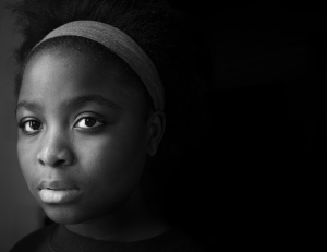 "Salome Kasinge, 14, was born in the Democratic Republic of Congo during the Second Congo War, shortly before her family fled to Zambia, where they lived in the Mwange Refugee Camp until resettling in America in 2010. ""I miss Africa, but America is good too. Everybody has freedom to do whatever they want, to be whoever they want, without anybody judging them or without anybody killing them"" said Salome."