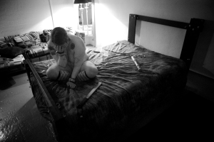 "River (27), weeps alone on her bed before she receives ""aftercare."""