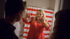 Hannah examines a bag of marijuana at a gathering with friends. Hannah often questioned her use of substances for personal enjoyment or fulfillment.
