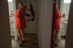 "Hannah is reflected in the mirror at home as she gets ready for a party. Hannah can spend hours getting ready to go out because of her need to look perfect. ""I'd rather stay inside than go out ugly,"" Hannah says."