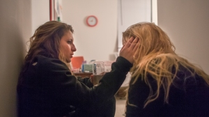 Hannah is held by her girlfriend, Courtney, after a rough night from a party. Hannah says her and Courtney weren't dating when she was at her worst, but she was there when she was at her worst.