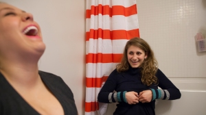 Hannah and Courtney laugh as they, joke around in the bathroom. Since being in a relationship, Hannah sees more things worth laughing and living for. Courtney provides a source of hope for Hannah.