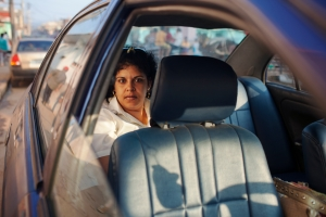A woman waits in the back of a taxi in Trinidad, Cuba, on March 24, 2014.