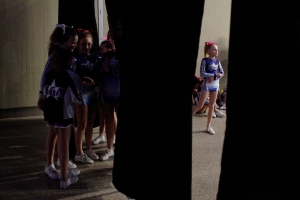 Girls competing at the youth level, ages 11 and younger, wait for their turn on stage at American Majestic, a national qualifying competition in Buffalo, NY, on March 1, 2014.