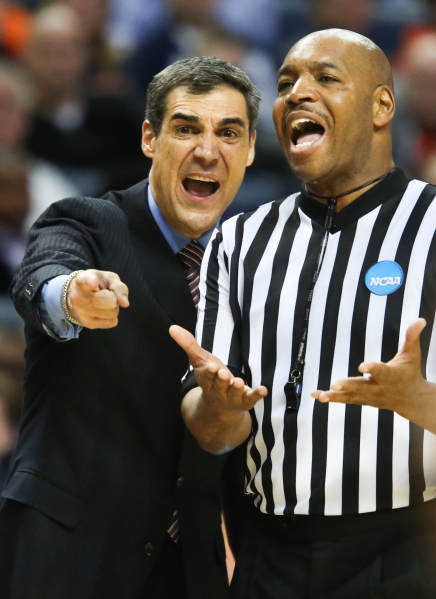 Head coach Jay Wright of the Villanova Wildcats argues a call with official Antinio Petty as his team trails late in the second half against the Connecticut Huskies during the third round of the 2014 NCAA Men's Basketball Championships at the First Niagara Center on Saturday, March 22, 2014 in Buffalo, N.Y Villanova lost 77-65. Photo By Josh Barber